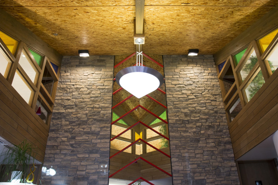 Lobby featuring stone, brick, and stained glass