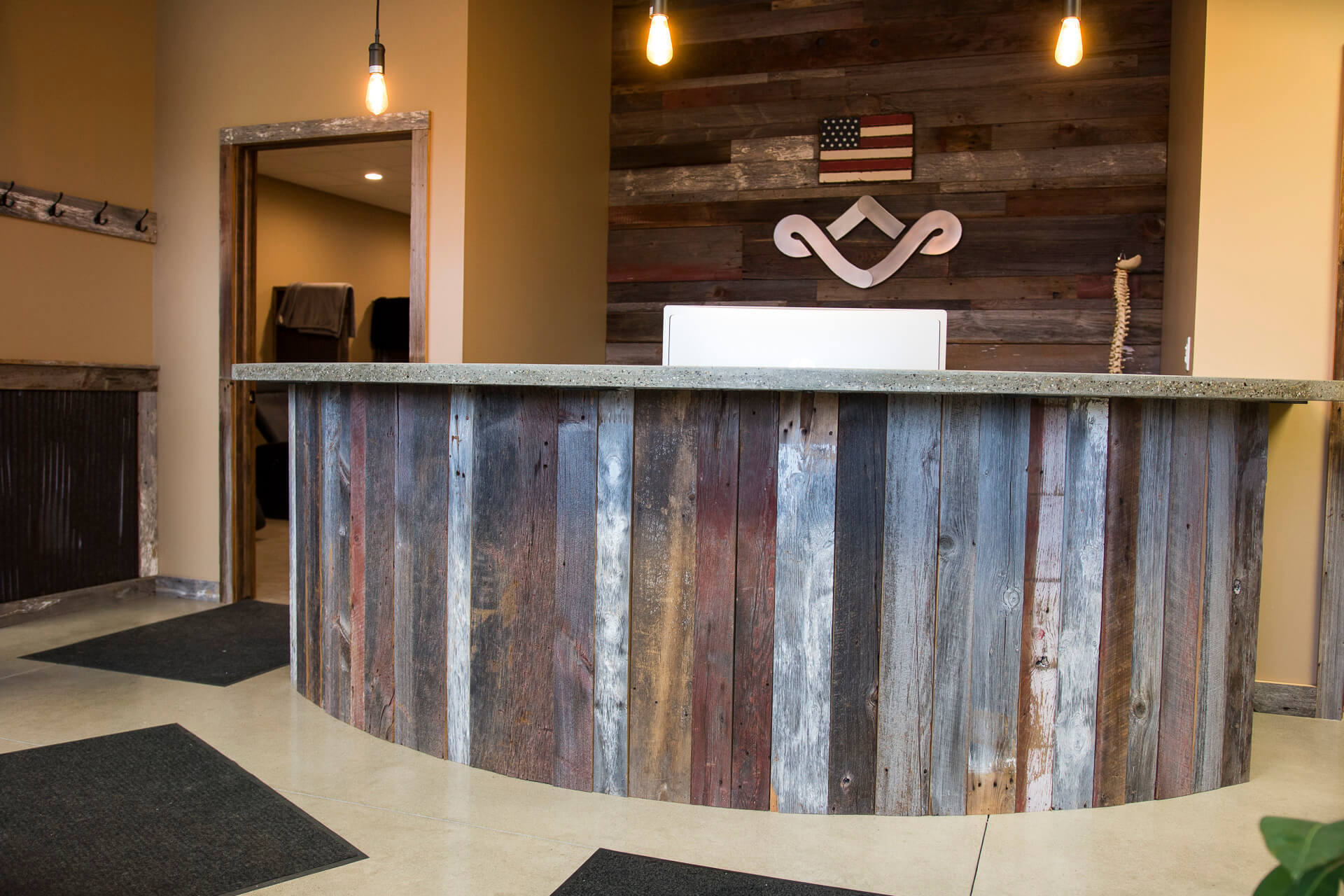 Lobby featuring barn wood and rustic lighting