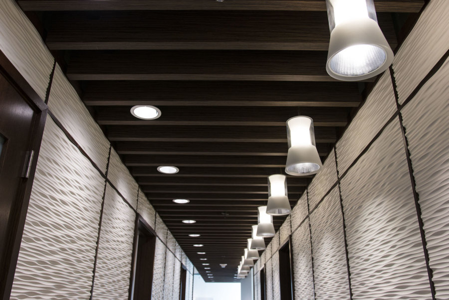 Composite ceiling panels in hallway